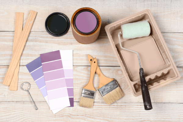 Painting supplies with brushes, color swatches, and paint